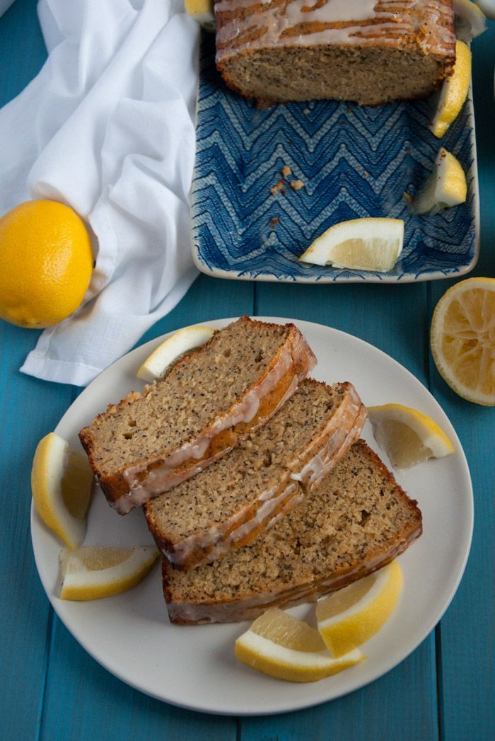 Delicious, light lemon poppy seed bread made with 100% whole wheat flour, agave, coconut oil, and topped with a zesty lemon glaze. - Feasting Not Fasting