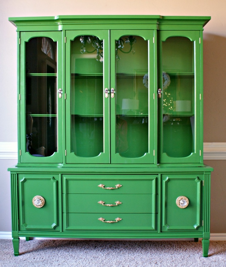 An amazing transformation on a boring brown cabinet turned into a stunning piece of furniture