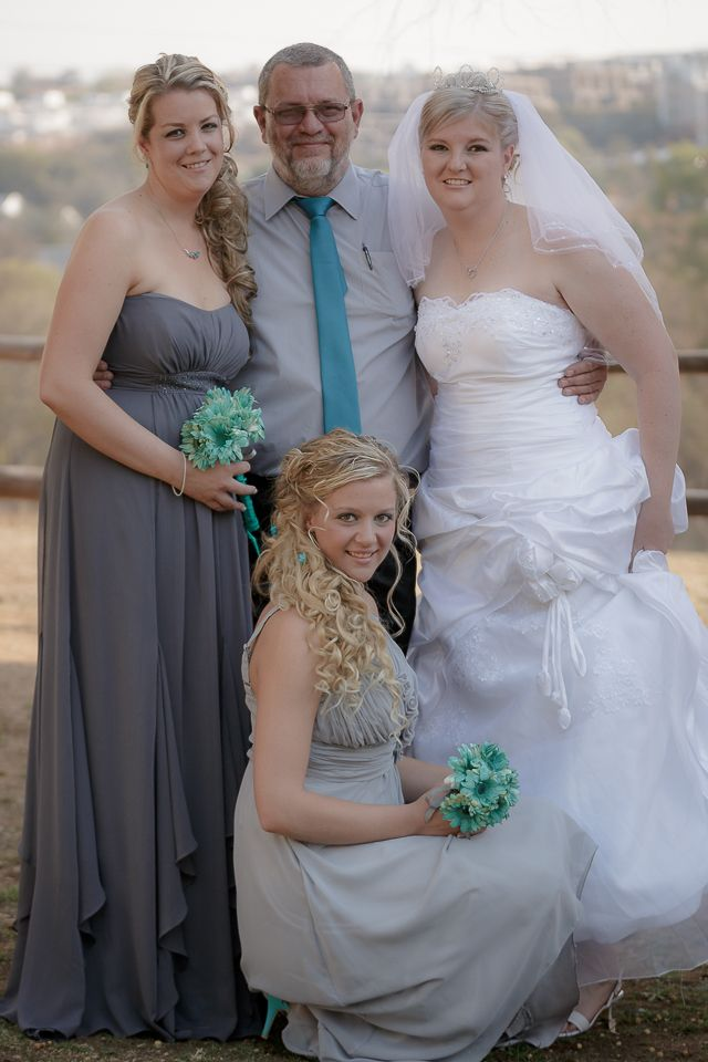 Very proud father with his three daughters; the bride, maid of honor and brides maid
