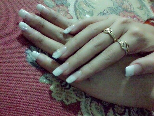 A very soft french manicure with lil swarovski