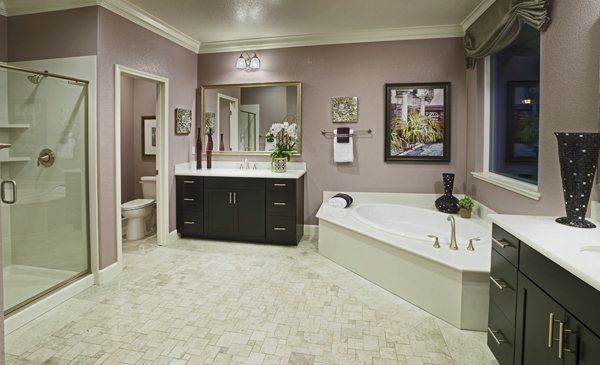 This bathroom from @Lenna Dahlquist Rivera NorCal features double sinks, a corner tub and a spacious shower. Soft lilac walls also add a special touch to this beautiful bathroom.
