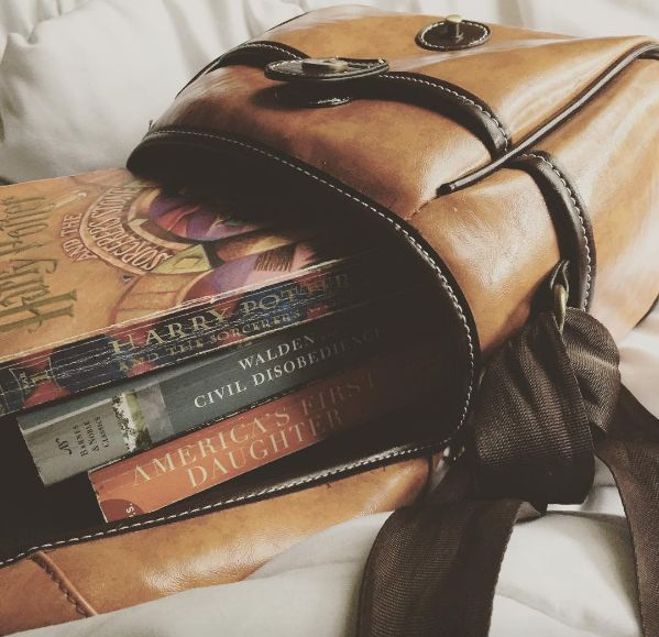 """youngmindsneedstories: """" Books & Cupcakes Book Photo Challenge of June 2016: Books in a Bag. My camera bag's been super lonely since I sent my Nikon in for repairs. This oughta help. """""""