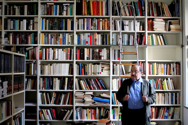 Umberto Eco in front of the bookshelf in his library which contains books he has written and translations. Milano, May 9th, 2011.