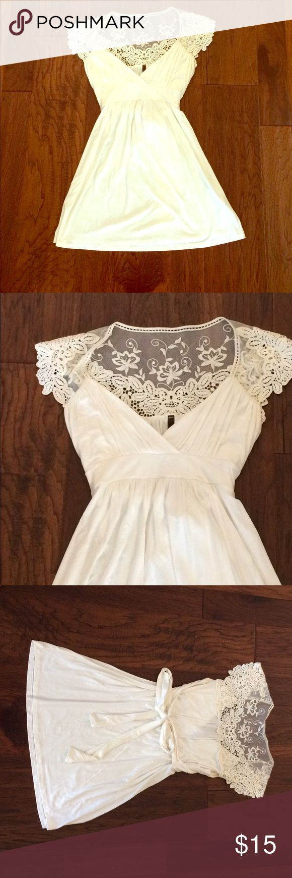 Long cream short sleeved top with lace detail Long cream colored short sleeved top with empire waist and tie under bust. Beautiful lace detail and v-neck. Longer length could be a tunic on a shorter person. Worn only once. princess ri riu Tops Blouses