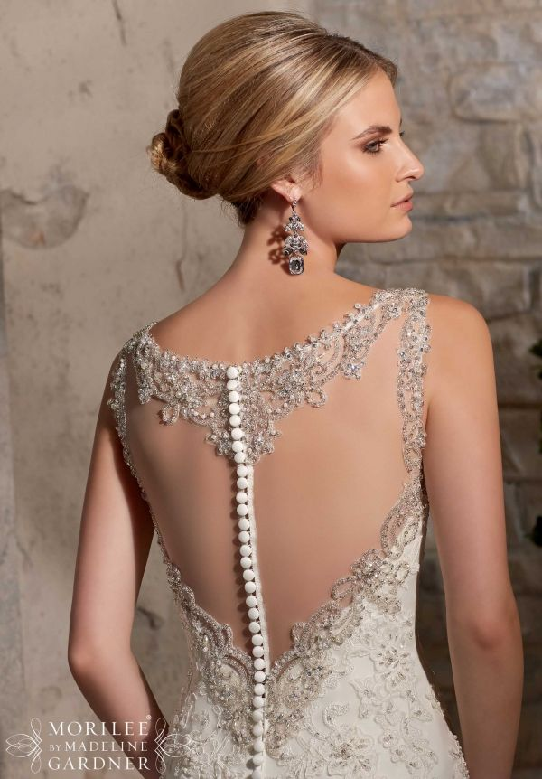 2710 Bridal Gowns / Dresses Crystal Beaded Embroidery Accents the Alencon Lace Appliques on Net