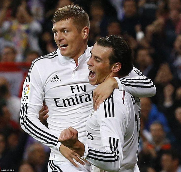 Gareth Bale celebrates his goal against Rayo Vallecano with team-mate Toni Kroos.