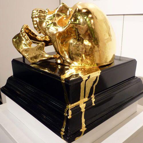 Melting gold skull