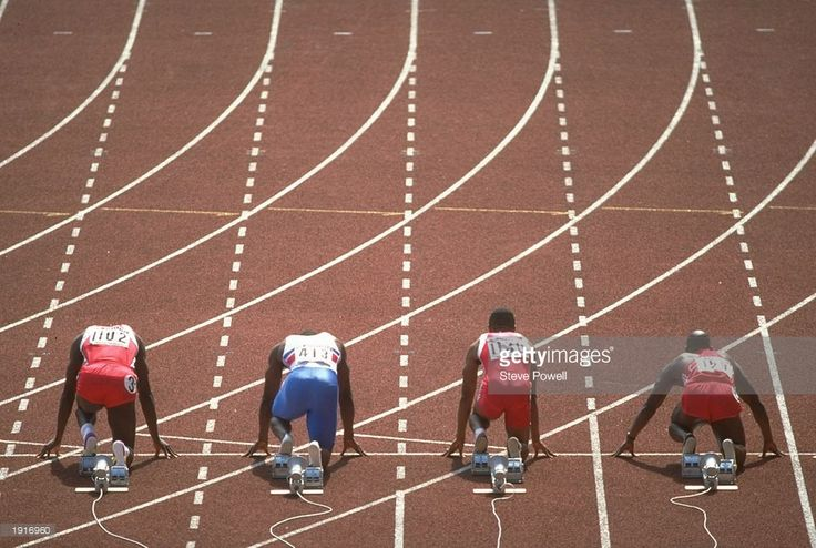 Carl Lewis (left) of the USA, Linford Christie (seond left) of Great Britain, Calvin Smith (second right) of the USA and Ben Johnson (right) of Canada at the start of the 100 Metres Final at the 1988 Olympic Games in Seoul, South Korea. Lewis won the gold medal Christie won the silver and Smith won the bronze medal in this event. Johnson was disqualified for failing a drugs test. \ Mandatory Credit: Steve Powell/Allsport