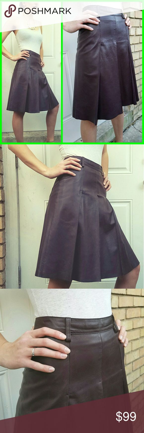 "Vintage  $1100 MIU MIU Wine LEATHER A-LINE Skirt ABSOLUTELY FABULOUS vintage 2003 MIU MIU PRADA-era Wine Leather A-LINE Skirt...TO DIE FOR!   Thick, durable AND EXTREMELY HIGH-END  ******CURRENT RETAIL FOR MIU MIU A-LINE LEATHER SKIRT OF THIS QUALITY IS $1100.******   RARE COLOR IS BEAUTIFUL and goes with EVERYTHING!   Marked a size IT 40 - fits a current U.S size Small:  Approx 24"" long, 27/28"" waist, up to 40"" at hips~ Vintage  Skirts A-Line or Full"