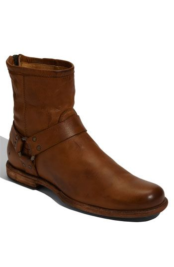 This is the Phillip Harness leather boot by Frye. This boot is distressed by hand which gives it the perfect vintage finish. The cognac colored leather is the perfect shade that can be paired with virtually anything!! Love this boot!!!