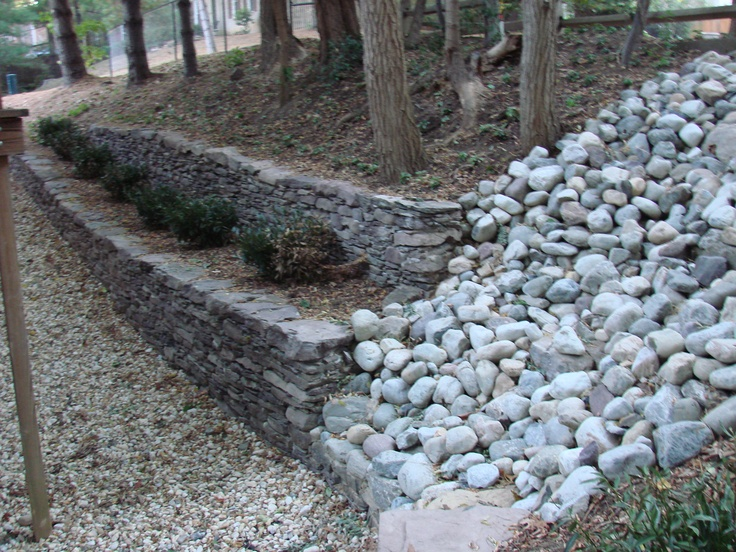 Stone retaining wall and stream bed stabilization in one! | Drainage and Erosion Solutions #landscaping