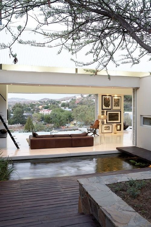 Wow! Can you believe this house? It opens completely to the outside, there's a koi pond, and of course that gorgeous view. *sigh*