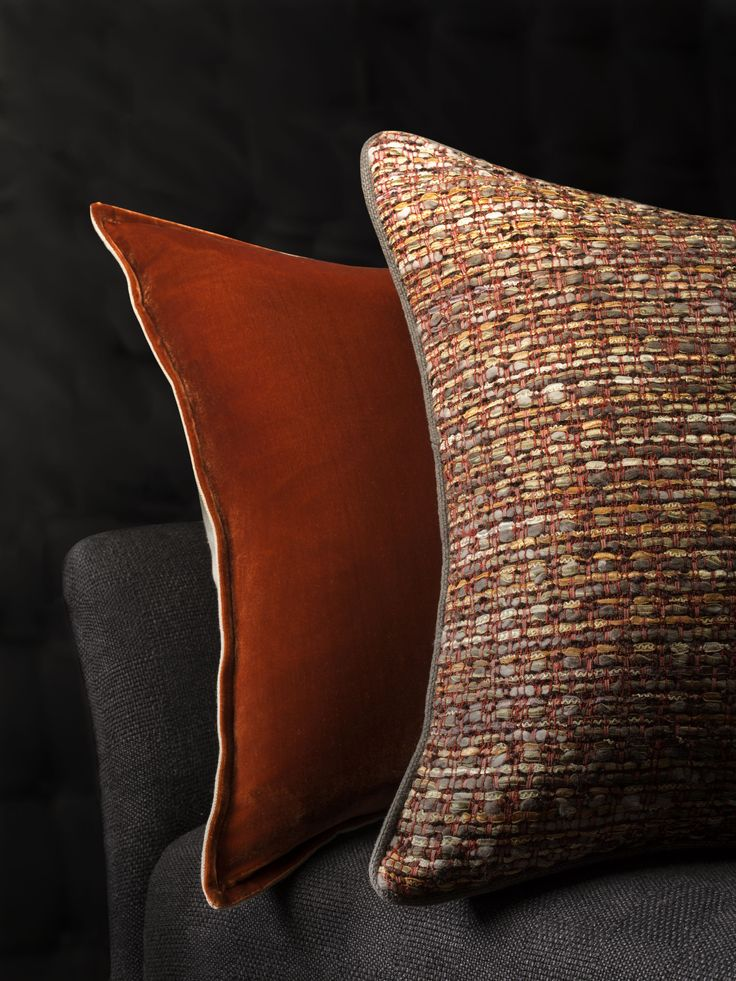 Silk Velvet Burnt Orange Cushion and Persia Cushion in Pomegranate. The tweed is woven on handlooms in ribbon, tapes and raw linen. This classic cloth is re-invented for stylish interior accessories.