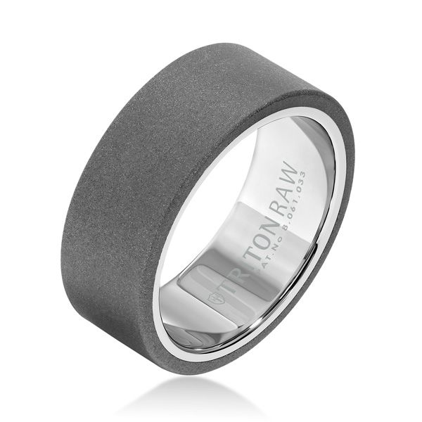 We're in love with this flat profile 9mm Tungsten Carbide band with high shine white nano-tech coating inside. Ring by Triton RAW