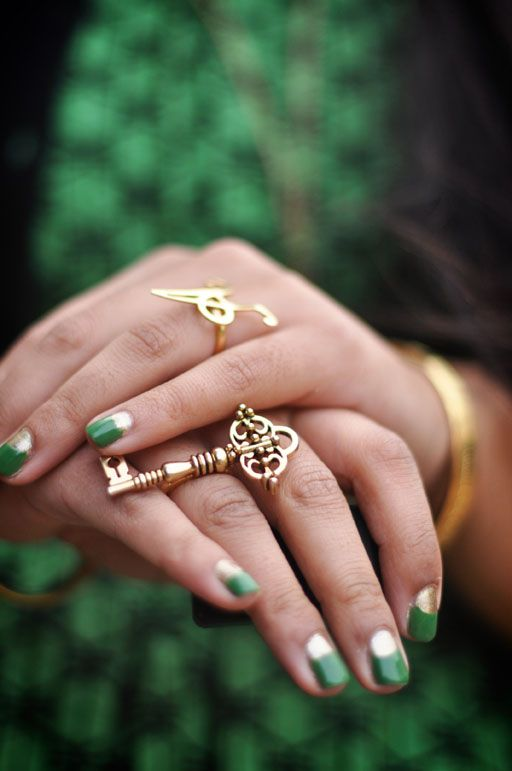 gold + emerald nails.