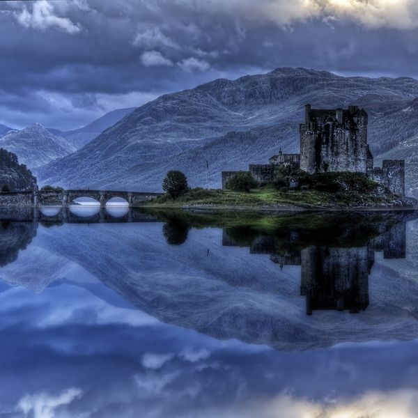 Eilean Donan Castle. Scotland.  Built in the 13th century to hold back the Vikings, today Eilean Donan Castle is one of the most famous sites in Scotland. Most probably it was named after Bishop Donan who came to Scotland in the 6th century. It is situated on an island, surrounded by the amazing scenery of the Scottish highlands. The fortress has been rebuilt at least four times and for around 200 years (from 18th to 20th century) it actually laid in ruins.