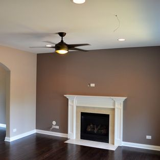 The main color is Sherwin Williams SW6079 Diverse Beige, and the fire place accent wall is Sherwin Williams SW6039 Poised Taupe. Both are in a Flat Finish. The trim is Sherwin Williams Bright White, Semi-Gloss.