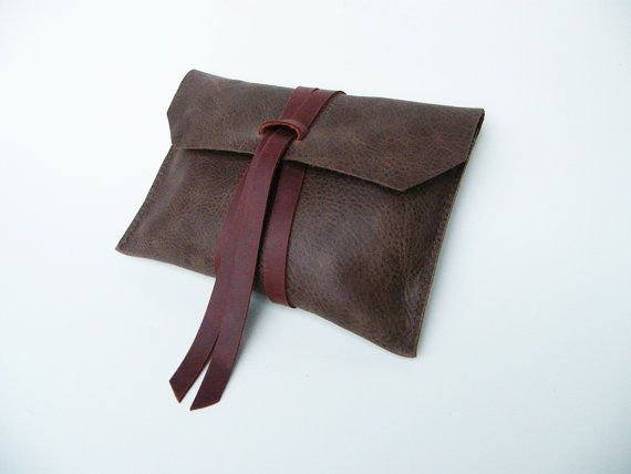 Leather Clutch  Minimal, modern, and stylish    Hand cut genuine leather with durable leather tie closure  Stitched with nylon thread on an