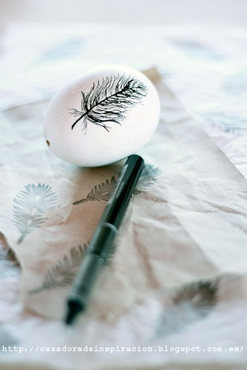 Idea: fill glass tank vases with black and white feather eggs