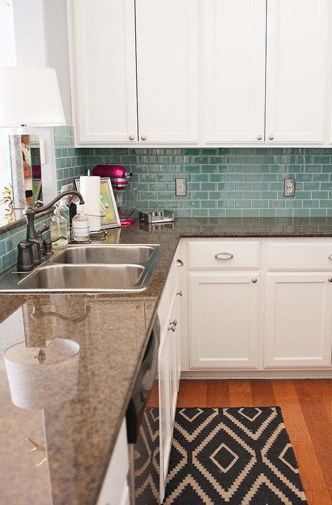 Katie Taylor's Austin, Texas Home Tour #theeverygirl Love the glass tile backsplash and of course white cabinets.