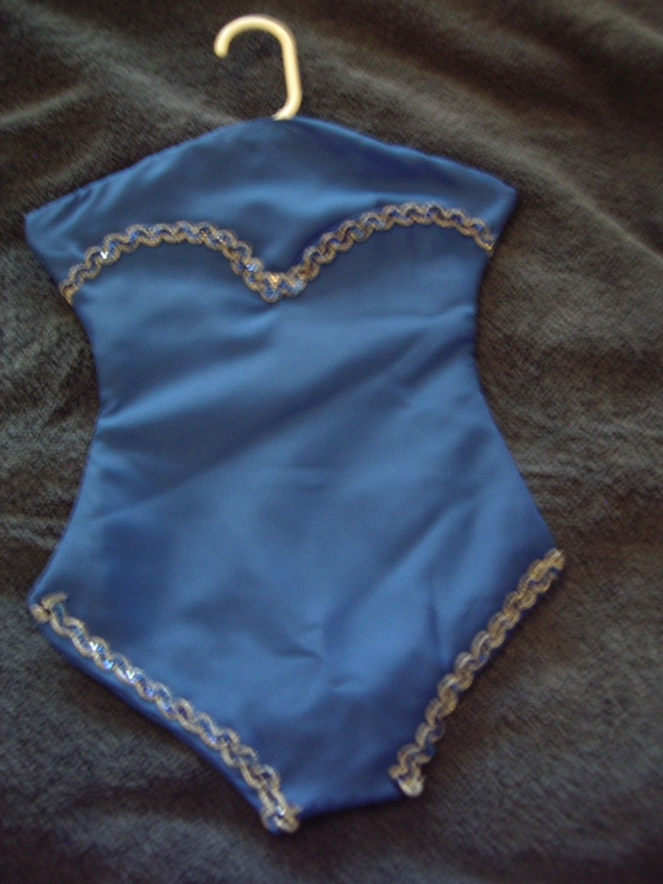 Blue crepe trimmed with blue/gold trim. This is a Lingerie Keeper I made.  It opens along the bustline to a full length pocket. This could also be used as a Santa Stocking for hiding Christmas goodies.