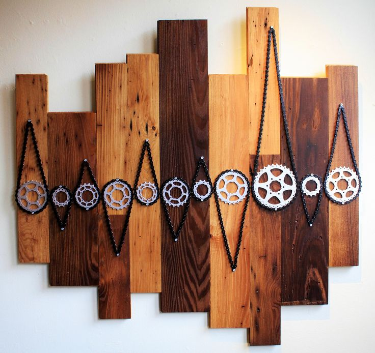 This is SO COOL!!! I would love to make something like this as either art or like a coat rack or something! Oh! Or a headboard for a bed! Even cooler!