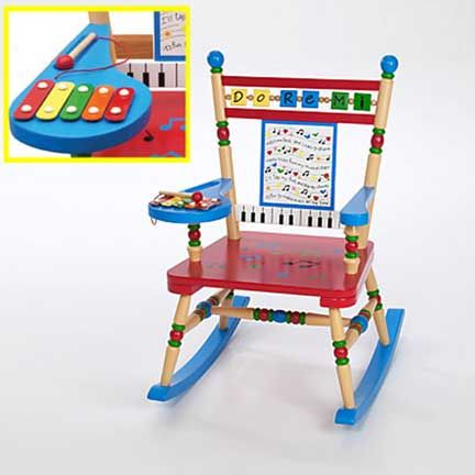 Musical Rocker by Levels of Discovery Mini five-note xylophone with wooden mallet attached to arm Whimsical keyboard and sheet music backrest with song