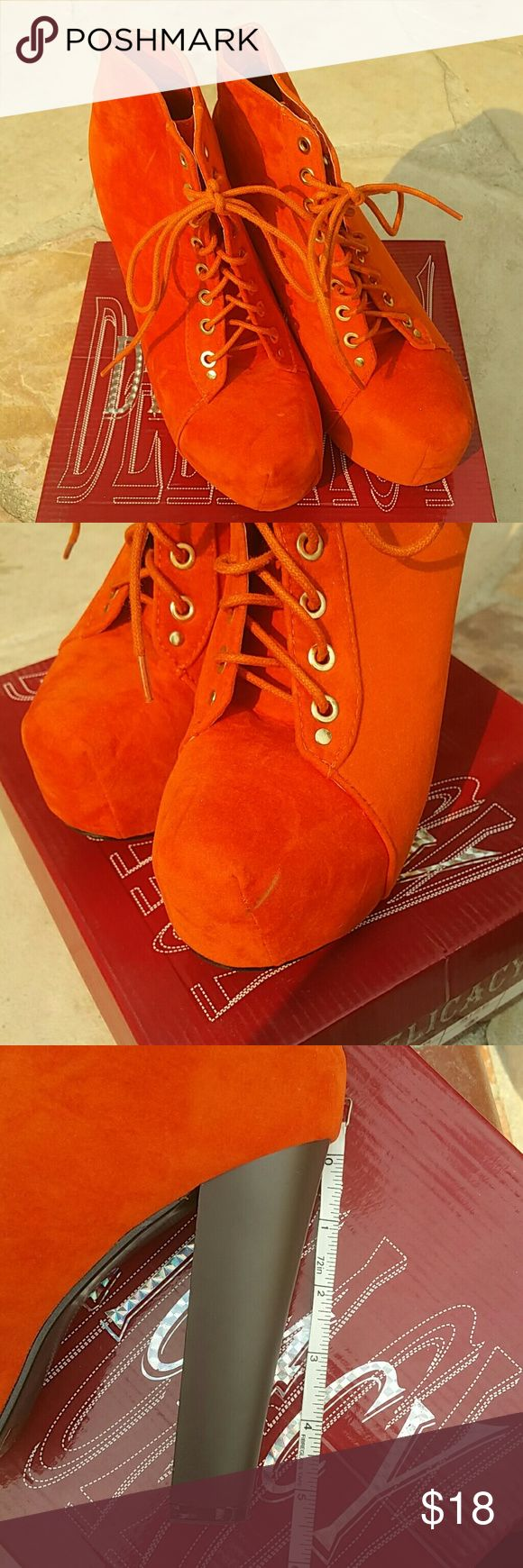 Beautiful Orange Ankle Bootie These are in like new condition. Worn for a couple hours only. The only flaw is shown on second pic. Other then that they are wonderful. Heel is approx 5in. Shoes Ankle Boots & Booties