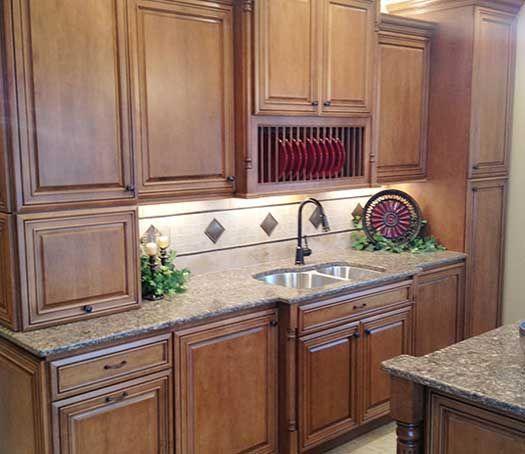Kitchen remodel designed by prairieland designs starmark for Chocolate maple glaze kitchen cabinets