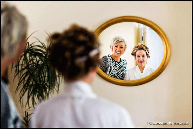 Laura checks out her hair before marrying Dan at the Tithe Barn in Petersfield -
