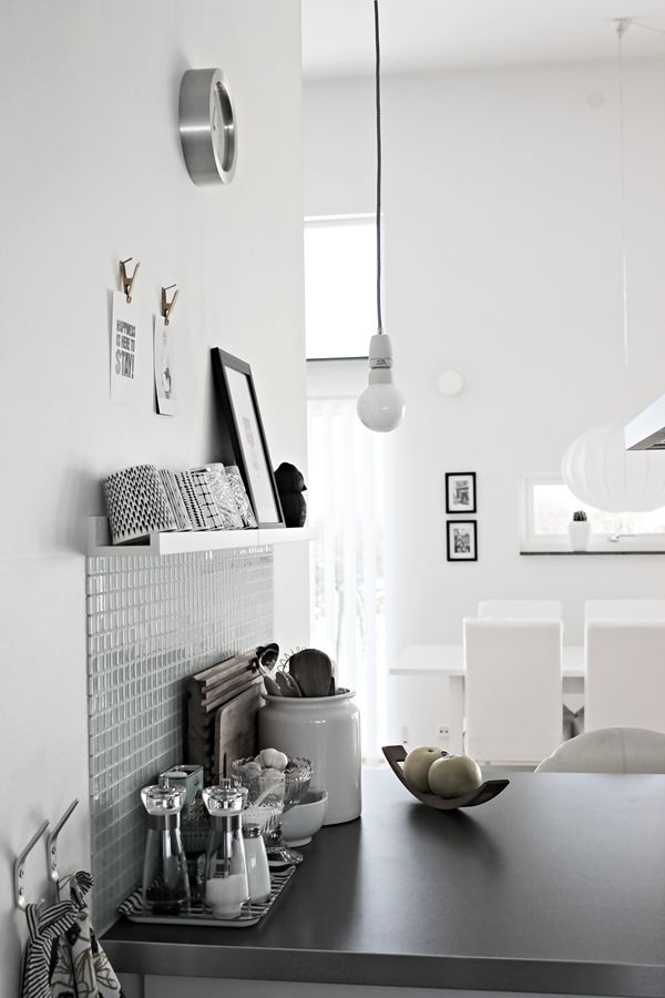 Grey and white kitchen. Love the glass mosaic splash back ( a lot) and the shelving. Very clean. Stunning.