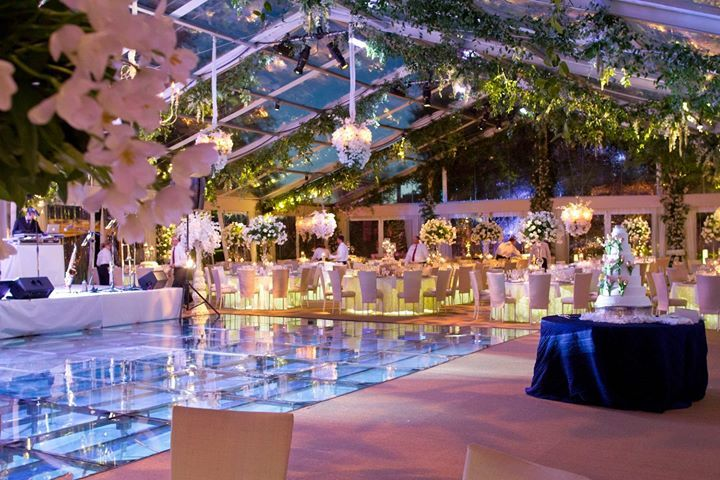 A glass cover over a swimming pool can turn it into an incredible dance floor ~ Inside Weddings