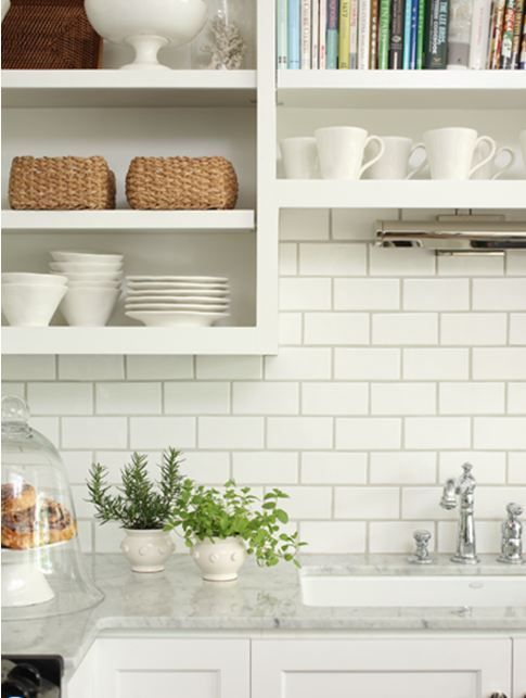 white subway tile backsplash ideas in a kitchen with marble countertops and white cabinets