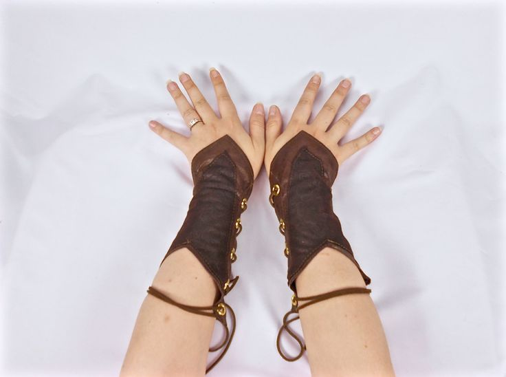 These gorgeous woodland elf gauntlets are the perfect finishing touch to a wood elf costume. Whether it be for Halloween, a costume party, fantasy cosplay or larp clothing, these authentic looking elvin arm bracers are just the thing to make you stand out from the crowd.  Inspired by fantasy movies, these are carefully crafted from two kinds of faux leather— the main body of the gauntlets are in a shiny weathered looking faux leather, and the overlay piece is a matte faux leather with an…