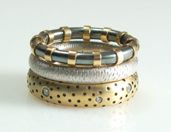 """Textured Stack"" Silver, Gold & Stone Ring Set Created by Susan Chin Silver, gold, and diamond stacking ring set. Total weight of diamonds in the Perforated Fat Band is 0.15ct."