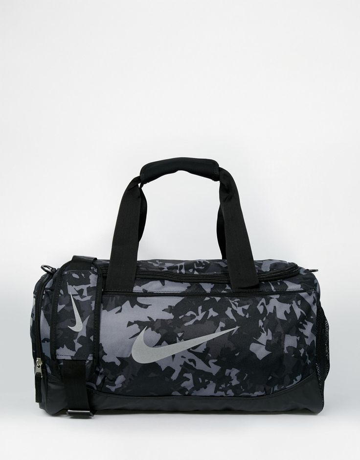 "Duffle bag by Nike Printed canvas Grab handles Adjustable shoulder strap External pocket Zip around opening Signature swoosh logo Wipe clean 100% Polyester H: 20cm/8"" W: 50cm/20"" D: 20cm/8"""
