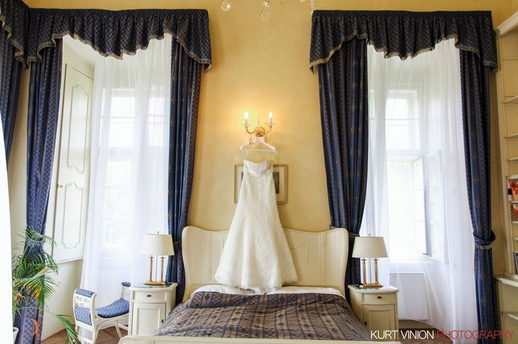 a beautiful wedding dress awaits the bride at the Chateau Mcely outside of Prague