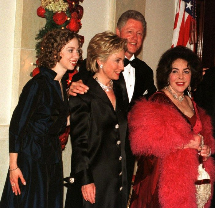Bill Clinton with wife Hillary, daughter Chelsea, and actress Elizabeth getting ready to Celebrate new years