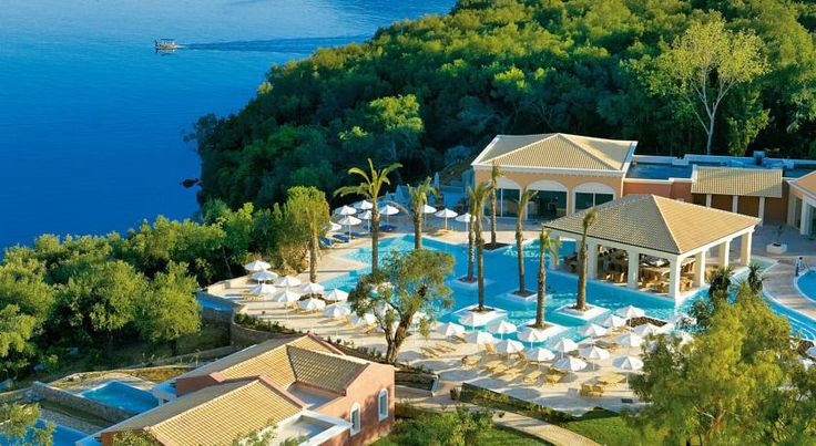 Grecotel Eva Palace Komménon Situated in Kommeno of Corfu, this beachfront resort offers panoramic views of the Ionian Sea and Corfu Town. Grecotel Eva Palace features a private beach and an impressive pool area with a bar.