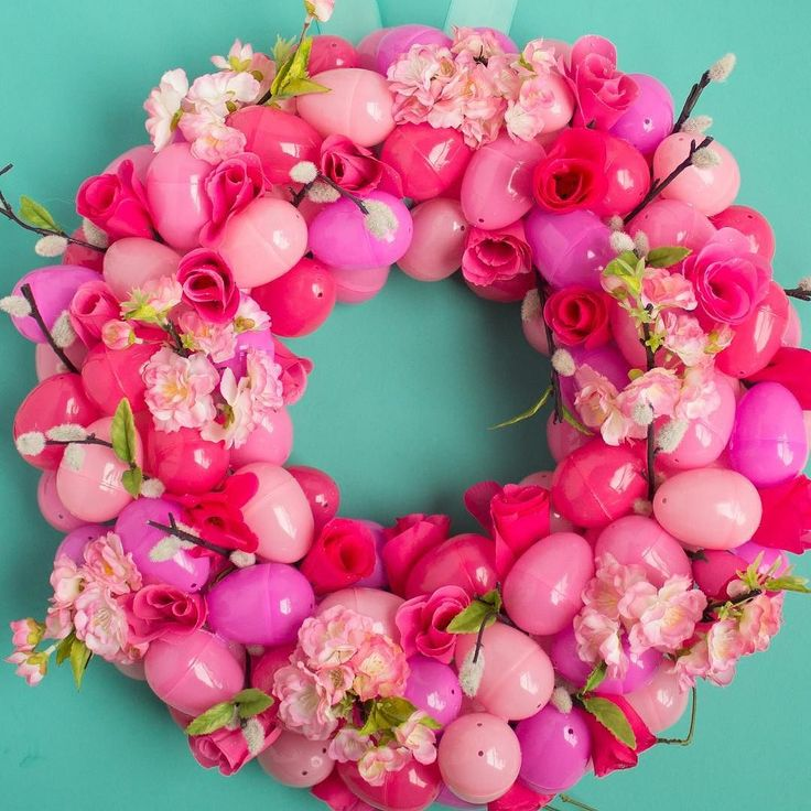 Oh the colors! Is this not the most beautiful Easter wreath? Learn how to make this Floral Ombre Easter Egg Wreath with @designimprovised over on our blog! #Easter #wreath #diy #orientaltrading