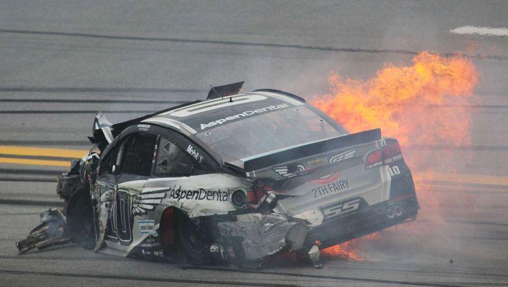 Flames trail Danica Patrick's car after she crashed into Matt Kenseth during the NASCAR Talladega au... - Greg McWilliams/AP Photo