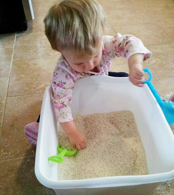 Sensory Play with rice and shovels!! She just loved this 15 months old