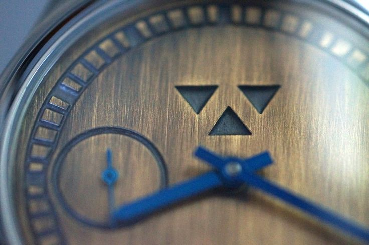 Macro shot of the dial from my Daedalian wristwatch with brass dial