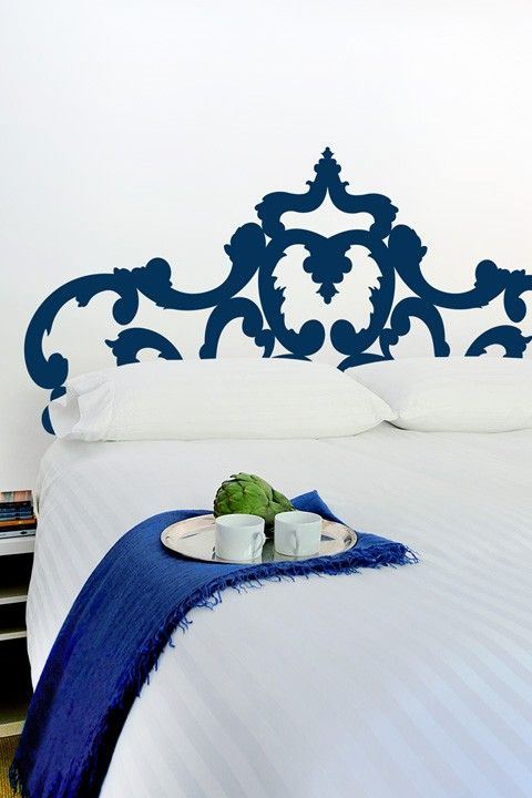The Sophie Headboard wall decal adds modern grace without the backache. Your movers will thank us.