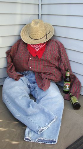 Make a drunken farmer or a scarecrow with clothes in your husband's closet or from Goodwill.