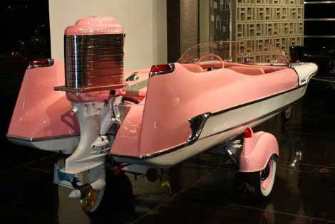 Those COOL fiberglass body boats of the 50's and 60's. Photo of a pink Meteor boat