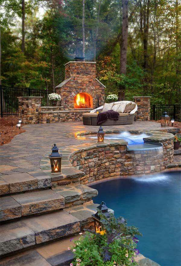 Backyard fireplace, hot tub and pool in rocks
