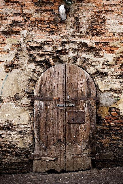 Old wooden door at mercato coperto di Cesena