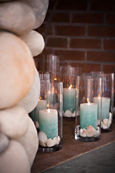 Teal candles and seashells (@Ashley Perry)