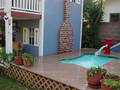 With a doghouse that includes a bone-shaped pool and three decorated bedrooms, this is one lucky pup.